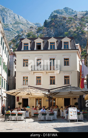 Buildings and restaurant in the old town of Kotor in Montenegro. - Stock Photo