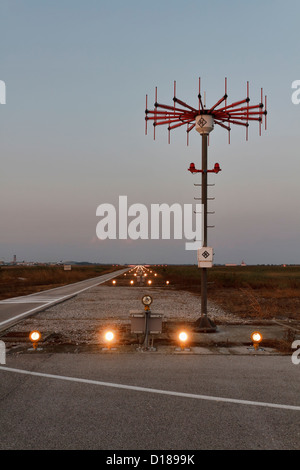 Italy venice international airport landing strip lights at sunset italy venice international airport landing strip lights at sunset stock photo mozeypictures Image collections