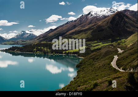 Aerial view of still lake and mountains - Stock Photo