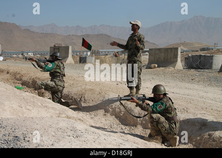 Afghan recruits exercise for combat at the military training centre (KMTC) in Kabul, Afghanistan, 6 November 2012. - Stock Photo