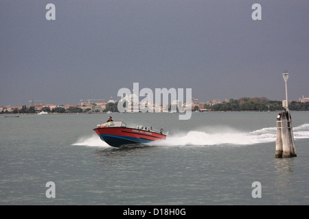Venetian firefighter in a Vigili del fuoco (fireboat) at the lagoon.