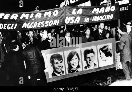 Anti-Vietnam War protest in Milan, Italy. The demonstrators hold a banner with pictures of the four students killed - Stock Photo