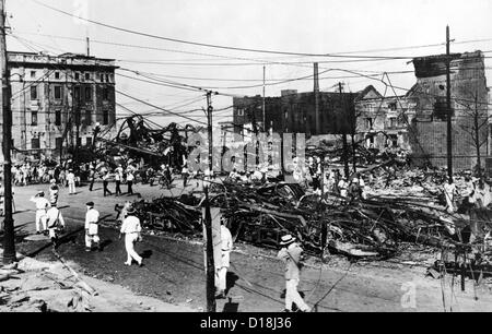 Ruins of burned streetcars after the 1923 Tokyo earthquake. The Great Kanto earthquake had a reported duration between - Stock Photo