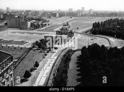 Aerial view of Brandenberg Gate, where the Berlin Wall forms a loop. East Berlin stretches into the distance. Aug. - Stock Photo