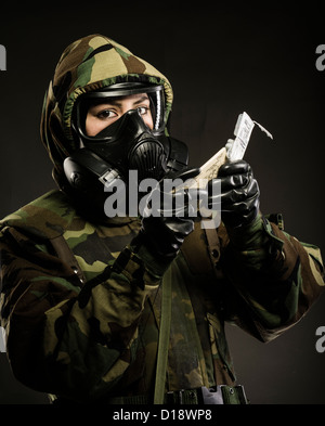 US Marine in MOPP gear inc gas mask uses M272 Chemical Agent Water Testing Kit ( lewisite, nerve agents, cyanide - Stock Photo