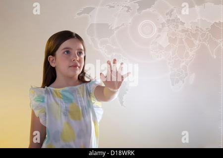 Girl touching virtual world map - Stock Photo