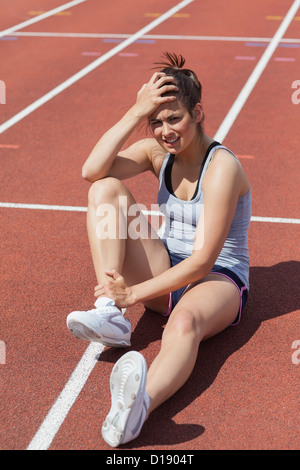 Runner with ankle injury - Stock Photo