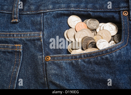 Us coins in jeans pocket - Stock Photo