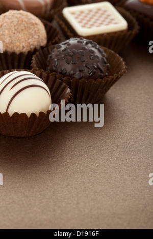 Assorted gourmet chocolate bonbons in paper cups - Stock Photo