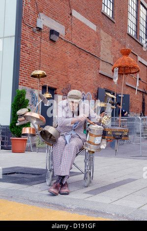 Comedian made up as a very old man playing drums during the Just for Laughs Festival in Montreal, province of Quebec, - Stock Photo