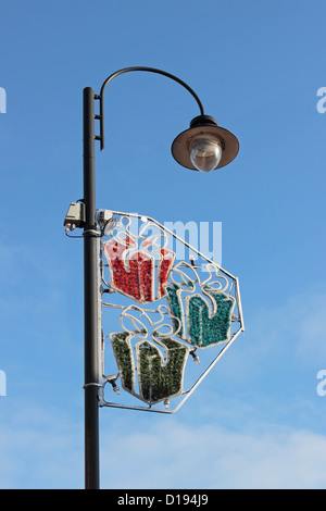 Street Light in Selby with Christmas Lights Fitted against clear blue sky - Stock Photo