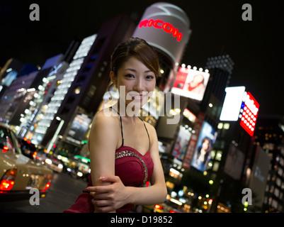 Japanese girl enjoying the shopping and nightlife of Ginza 4-chome, Tokyo, Japan - Stock Photo