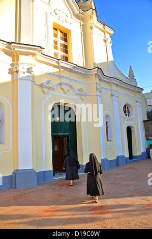 Two nuns walking towards a church Anacapri Capri Island Italy - Stock Photo