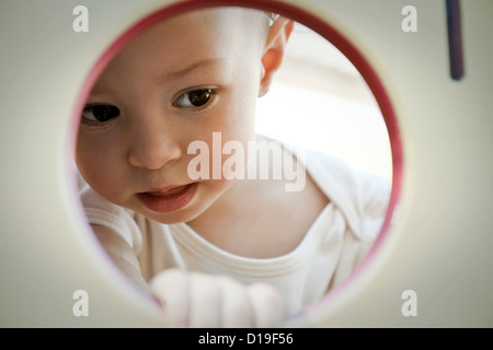 Little girl looking through circle - Stock Photo