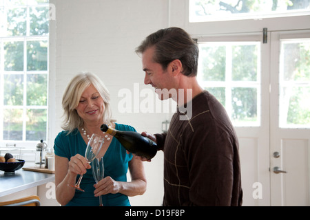 Man pouring champagne - Stock Photo