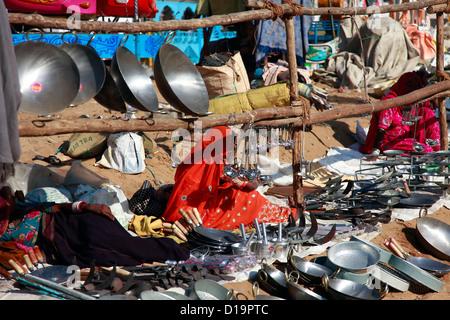 Metal utensils shop at Pushkar fair - Stock Photo