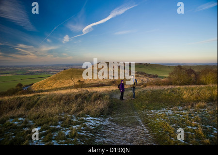 Walkers approaching Ivinghoe Beacon at the end of The Ridgeway National Trail, Buckinghamshire, UK - Stock Photo