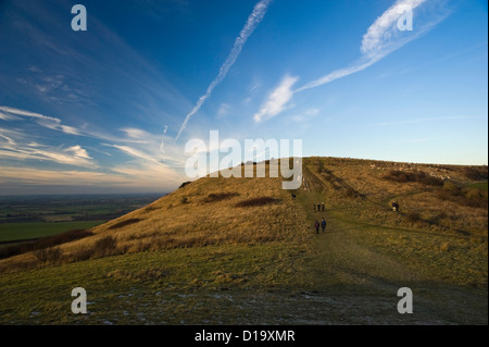 Walkers on Ivinghoe Beacon at the end of The Ridgeway National Trail, Buckinghamshire, UK - Stock Photo