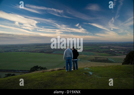 Two men survey the view from Ivinghoe Beacon at the end of The Ridgeway National Trail, Buckinghamshire, UK - Stock Photo