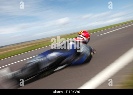 Street luge rider competes during 'Speed Days' held at Beachy Head, Eastbourne, East Sussex, UK. - Stock Photo