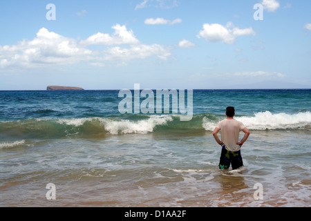 Man wading in the Pacific Ocean at Little Beach, Maui, Hawaii - Stock Photo