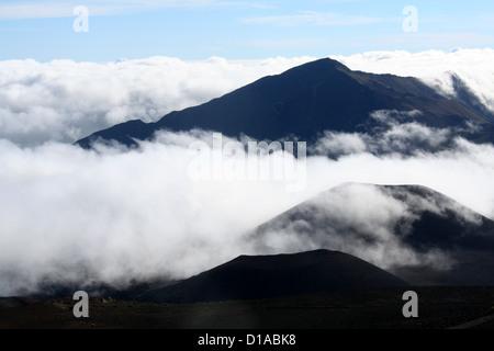 Fog and clouds among the cinder cones on Haleakala volcano, Maui, Hawaii - Stock Photo