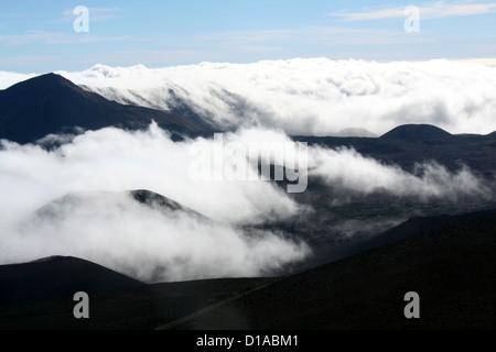 Fog and clouds among the cinder cones in Haleakala volcano, Maui, Hawaii - Stock Photo