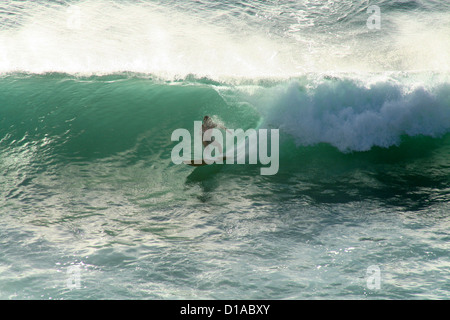 Surfer riding tube wave, Maui, Hawaii - Stock Photo