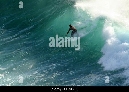 Surfer riding a wave, Maui, Hawaii - Stock Photo