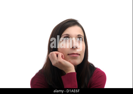 Portrait of young woman with a dreamy look on her face, isolated on white background - Stock Photo