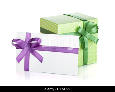 Gift box and letter with ribbon and bow. Isolated on white background - Stock Photo