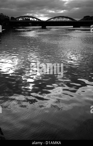 Looking up a stormy River Thames to Barnes Bridge, Barnes, London, UK - Stock Photo