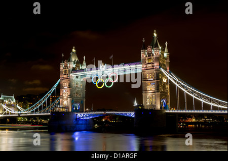 Tower Bridge is illuminated gold, to celebrate British rowers, Heather Stanning and Helen Glover, for winning the - Stock Photo