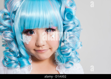 Portrait cute young woman in doll costume over