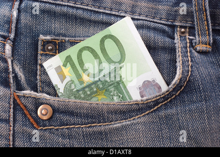 One hundred euro banknote in the jeans pocket. - Stock Photo