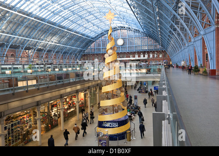 Christmas tree inside St Pancras Railway Station, London, England, UK - Stock Photo