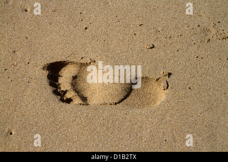 Footprint in the sand at Polihale Beach and State Park located on the western side of the island of Kauai, Hawaii, - Stock Photo