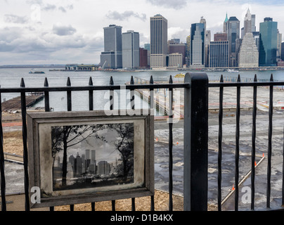 View of the Manhattan skyline and a photograph of the skyline before the '9 11' terrorist attack from Brooklyn Heights - Stock Photo