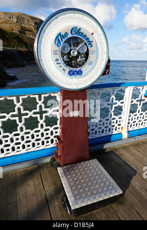 The Classic Coin Operated Weighing Scales On Llandudno Pier Wales UK - Stock Photo