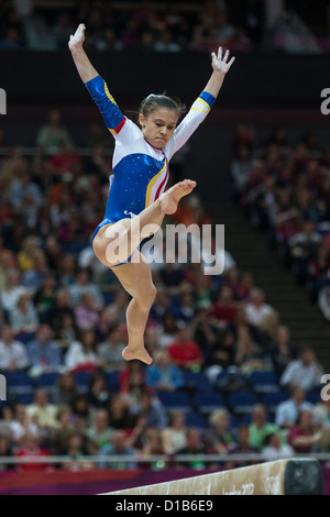 Diana Laura Bulimar (ROU) competes on the balance beam during the women's gymnastics team finals at the 2012 Olympic - Stock Photo