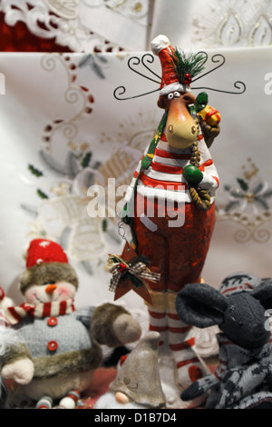 Christmas toys and decorations in a store window display in Bruges, Belgium - Stock Photo