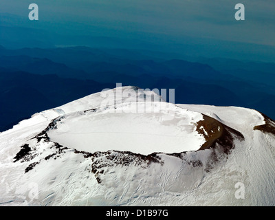 The very top of Mount Rainier east of Seattle Washington an aerial photograph of the caldera of an active volcano - Stock Photo