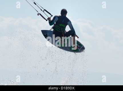 Kitesurfer jumping. Tarifa, Costa de la Luz, Cadiz, Andalusia, Spain. - Stock Photo