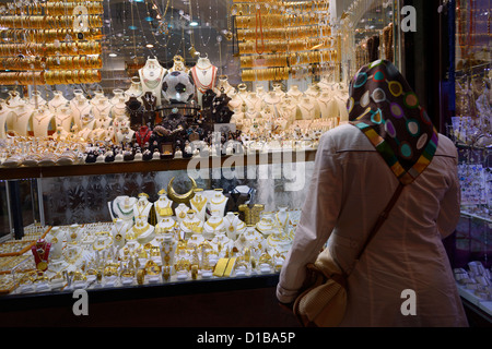 Turkish woman at a jewelery shop in the covered Egyptian Spice Bazaar Istanbul Turkey - Stock Photo