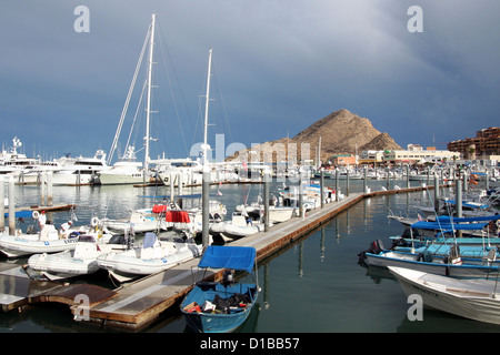 Boats and yachts at Cabo San Lucas Marina on a cloudy day - Stock Photo