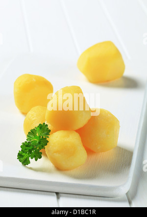 Cooked potatoes on cutting board - Stock Photo