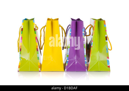 Four colored gift bags. Isolated on white background - Stock Photo
