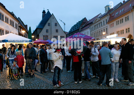 Sangerhausen, Germany, visitors during a town festival in the square - Stock Photo