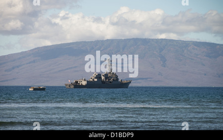 United States Navy Ship anchored off the coast of Maui, Hawaii. The island of Lanai in background - Stock Photo