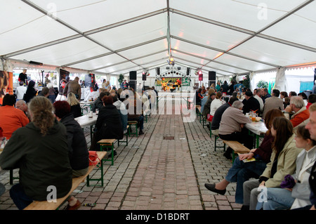 Suhl, Germany, a beer festival guests sit in the tent - Stock Photo